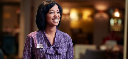 Premier Inn staff member available to help guests